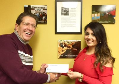 Founder and President Ps Frank Julian happy to present to Rand Yacoub our first WSU School of Pharmacy Scholarship of $500.